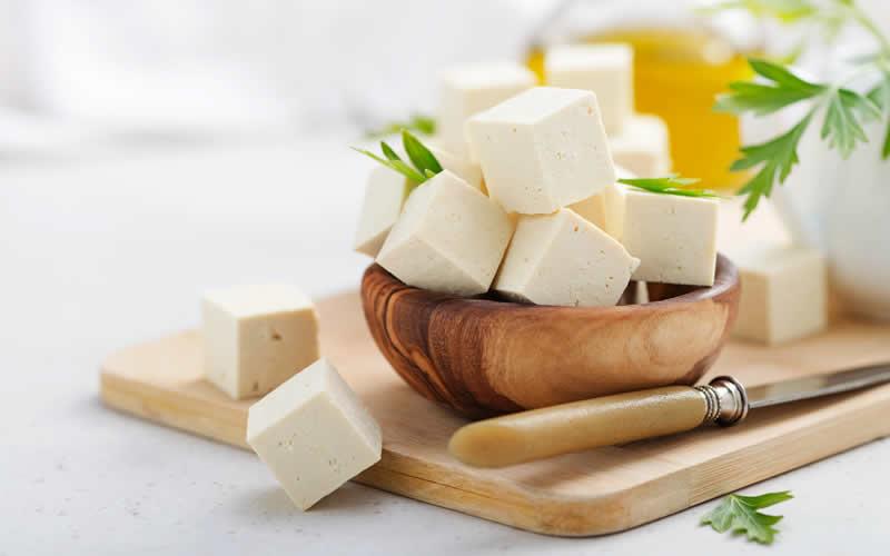 tofu chopped to feed to vegan dog