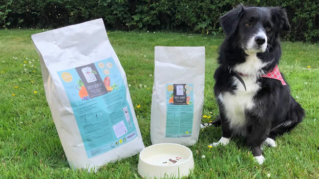 Vegan dog Ruff who bleongs to vegan vet sitting next to Green Crunch 7kgs plant-based dog food