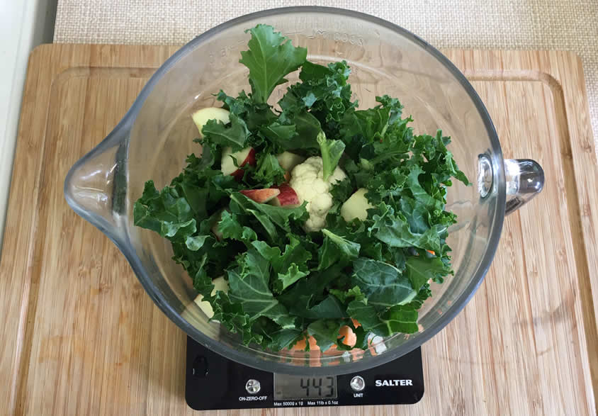 Weigh out all the chopped vegetables specific to your dog to add to the pressure cooker pot