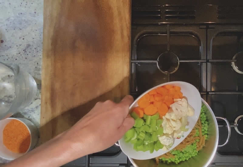 Chop and weigh out the correct amount of vegetables and add to the pot