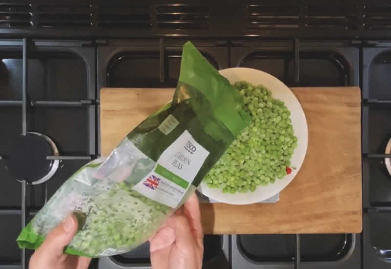 Carefully weigh out the correct amount of frozen peas for your dog